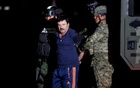 File Photo - Joaquin ''El Chapo'' Guzman is escorted by soldiers during a presentation in Mexico City, January 8, 2016. Reuters