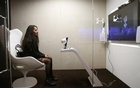 An attendee communicate with SARA, a socially aware robot assisstant, during a presentation at the annual meeting of the World Economic Forum (WEF) in Davos, Switzerland, January 17, 2017. Reuters