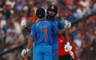 Cricket - India v England - Second One Day International - Barabati Stadium, Cuttack, India - 19/01/17. India's Yuvraj Singh congratulates his teammate Mahendra Singh Dhoni for his century. Reuters