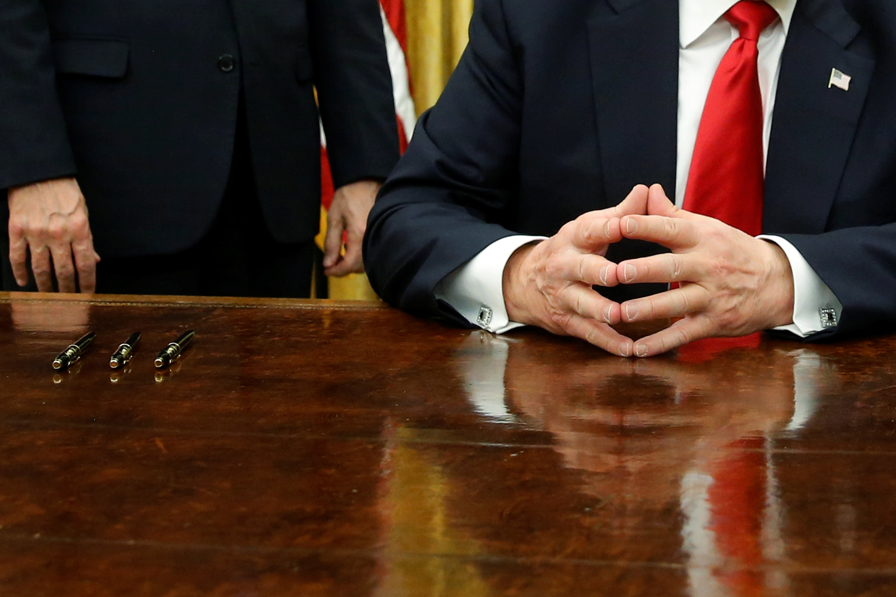 US President Donald Trump waits to sign his first executive orders in the Oval Office at the White House in Washington, US, Jan 20, 2017. Reuters