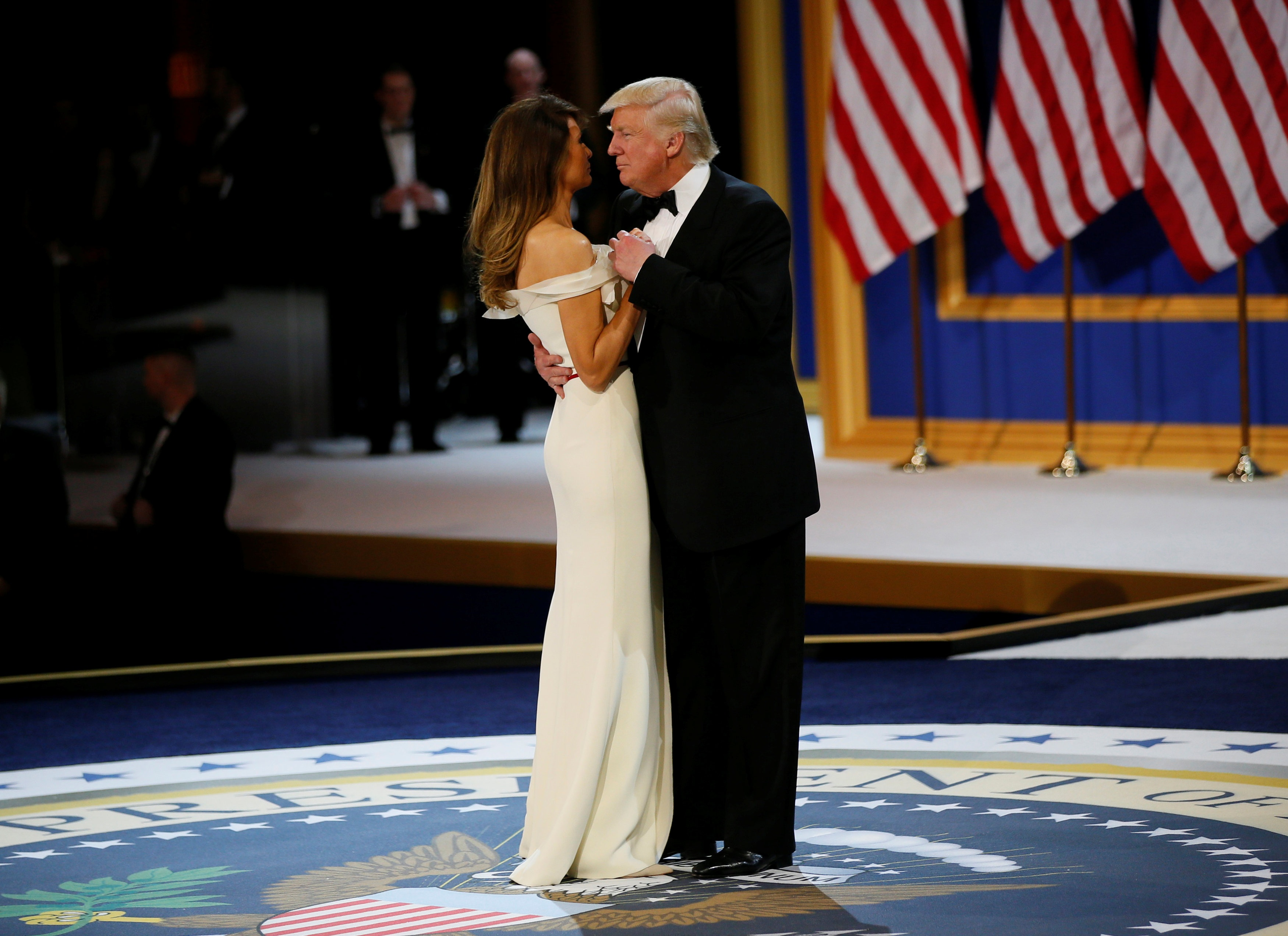 US President Donald Trump and his wife first lady Melania Trump dance at the