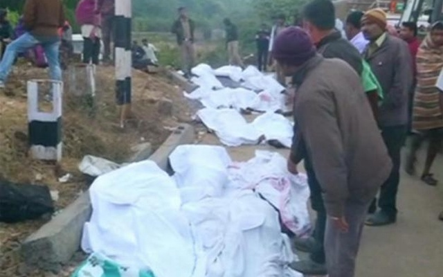 Bodies covered with white sheets are laid out after coaches of a Hirakhand express train from Jagdalpur to Bhubaneswar derailed near Kuneri station, Andhra Pradesh, outside the town of Rayagada, in this still image from video Jan 22, 2017. ANI via Reuters TV