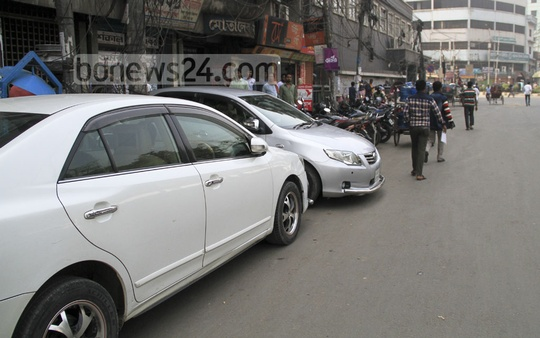 Unauthorised parking are very common in and around the capital. This picture is taken from Dhaka's Tikatuli on Monday. Photo: abdul mannan