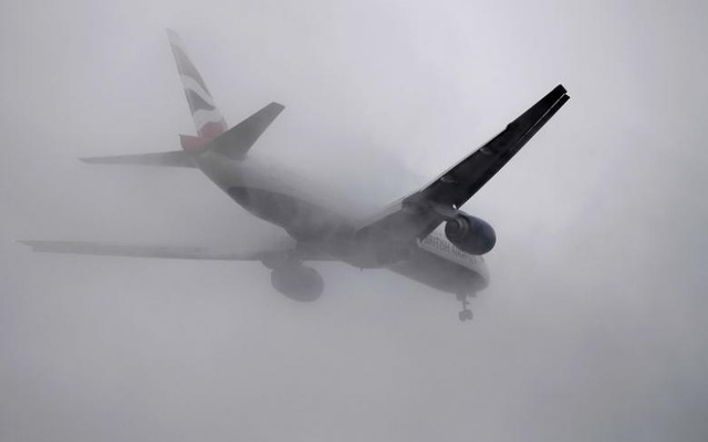 A British Airways passenger aircraft flies through low cloud as it prepares to land at Heathrow airport in west London, Britain, January 7, 2017. Reuters