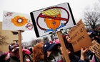 People gather for the Women's March in Washington on January 20 . Reuters