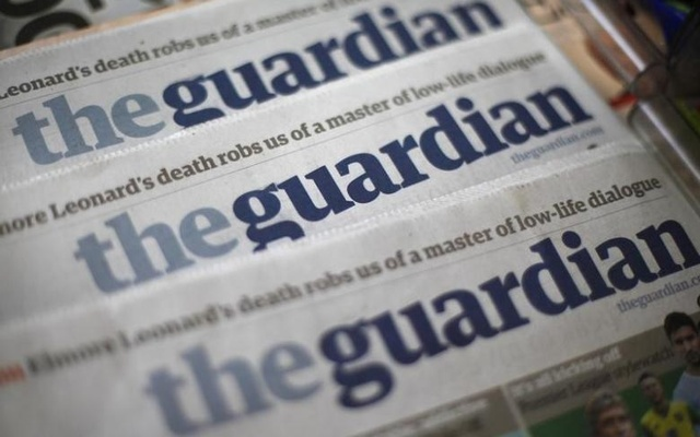 Copies of the Guardian newspaper are displayed at a news agent in London August 21, 2013. Reuters