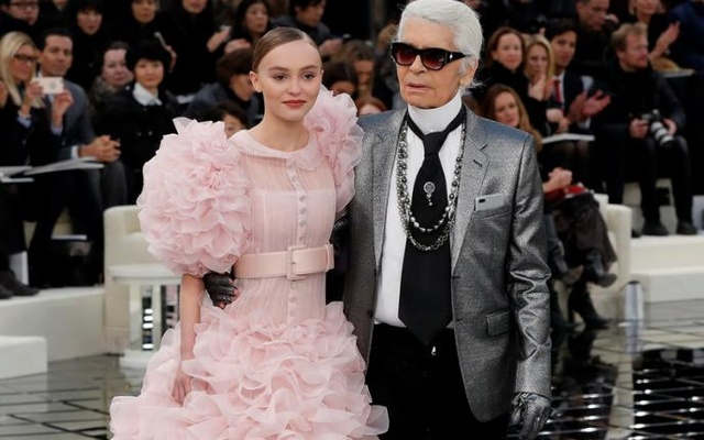 German designer Karl Lagerfeld appears with actress and model Lily-Rose Depp at the end of his Haute Couture Spring/Summer 2017 fashion show for Chanel in Paris, France, January 24, 2017. Reuters
