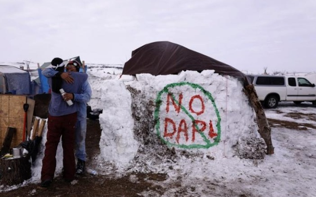 Benji Buffalo (R) greets a friend to his campsite inside of the Oceti Sakowin camp as 'water protectors' continue to demonstrate against plans to pass the Dakota Access pipeline near the Standing Rock Indian Reservation, near Cannon Ball, North Dakota, US, December 2, 2016. Reuters
