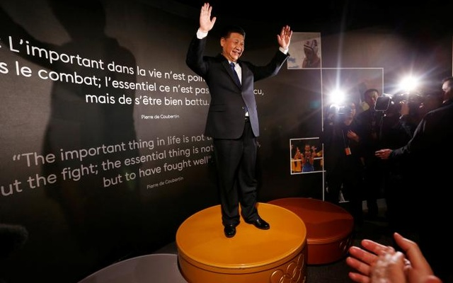 Chinese President Xi Jinping stands on the podium of the Sydney 2000 Olympic Games during a visit with IOC President Thomas Bach at the Olympic Museum in Lausanne, Switzerland January 18, 2017. Reuters
