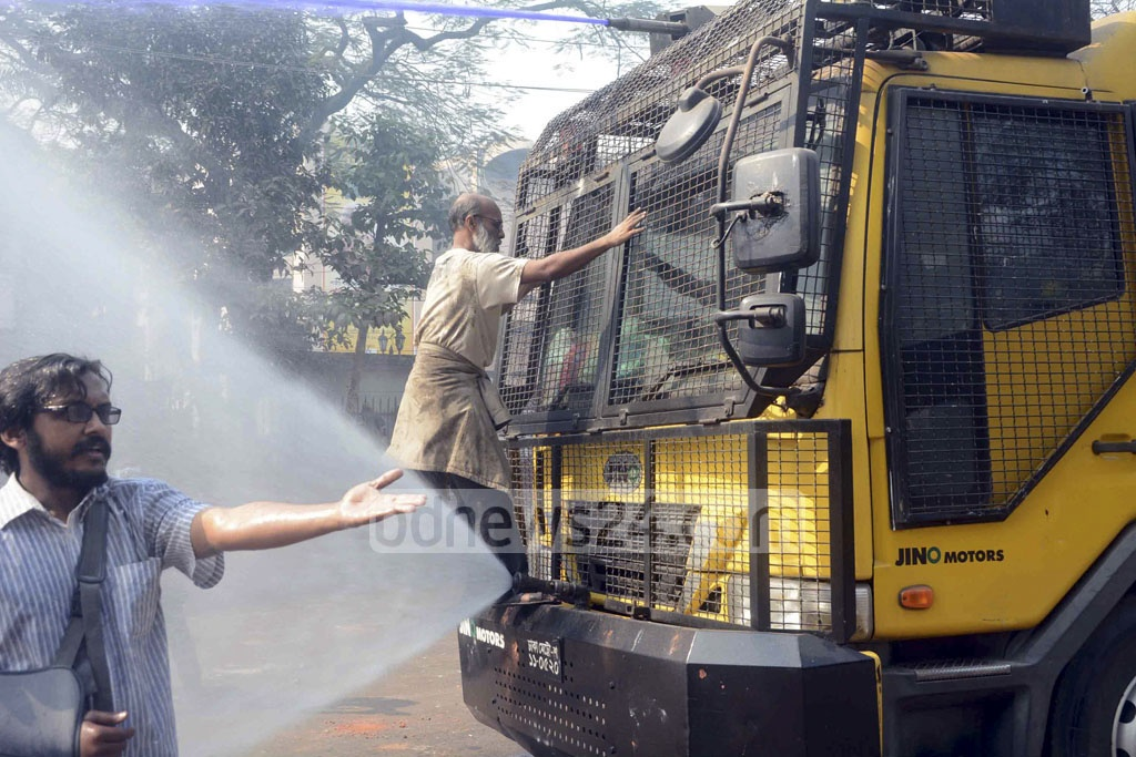 A protester climbs onto the top of a water cannon truck during demonstrations against the Rampal power plant project in Dhaka on Thursday. Photo: asif mahmud ove