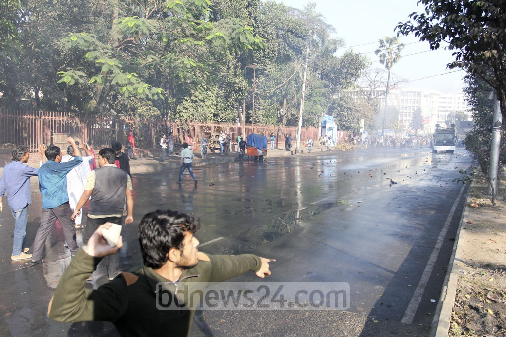 A protester hurls brickbats at police during demonstrations against the Rampal power point project in Dhaka on Thursday. Photo: asif mahmud ove