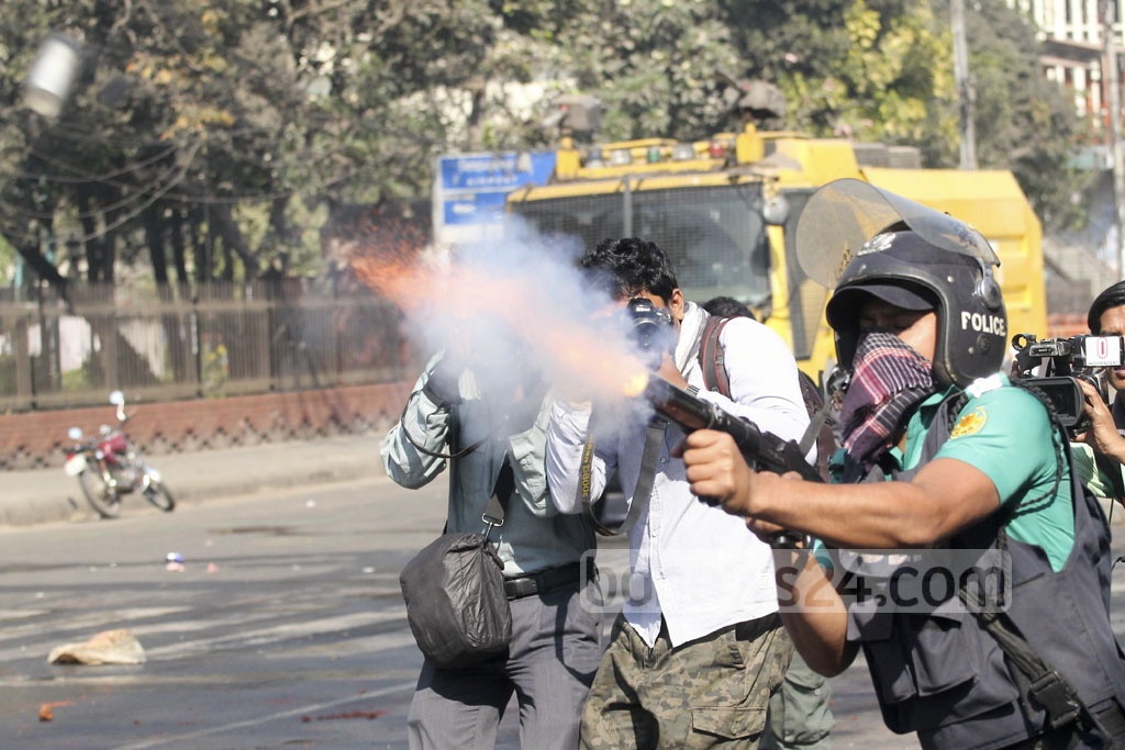 Police fire tear gas to break up demonstrations against the Rampal power plant project in Dhaka on Thursday. Photo: asif mahmud ove