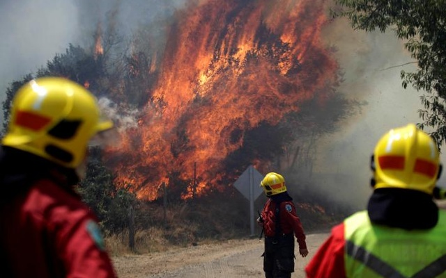 Firefighters are pictured during a forest fire in the town of Florida in the Biobio region, south of Chile. Reuters