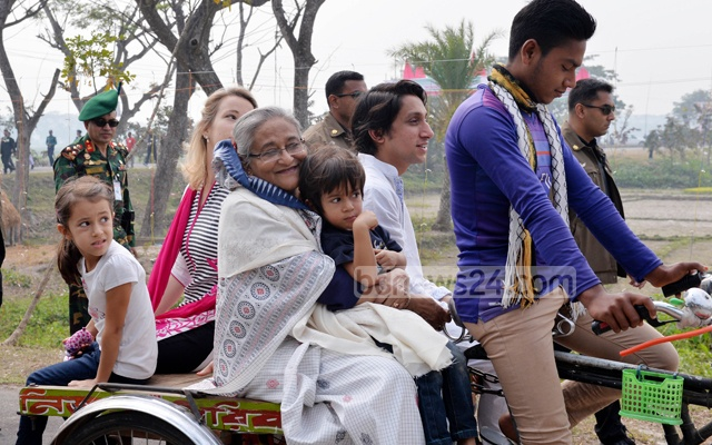 Prime Minister Sheikh Hasina takes a tour of her village home in Gopalganj on a rickshaw van with nephew Radwan Mujib Siddiq, his wife and children. Photo: PID