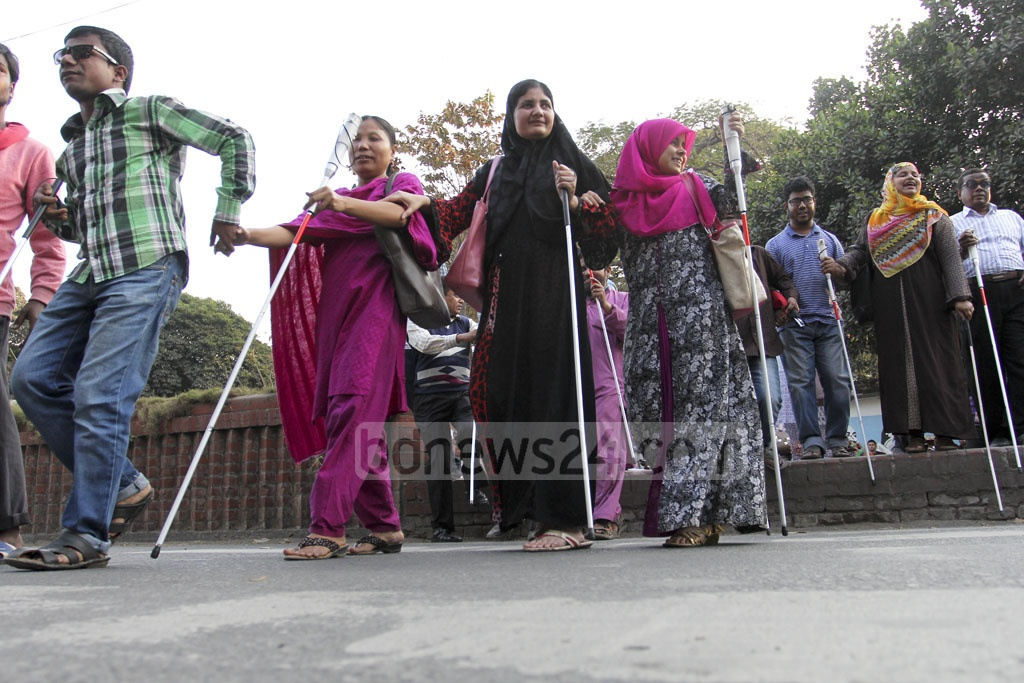 A road-crossing drill for people with visual disability was held in Dhaka University area on Sunday. Photo: asif mahmud ove