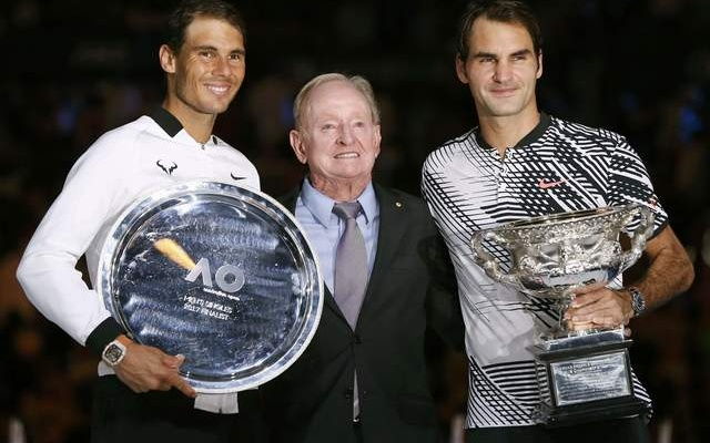 Switzerland's Roger Federer and Spain's Rafael Nadal pose with their trophies, with former Australian tennis player Rod Laver, after their Men's singles final match