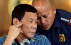 Philippine President Rodrigo Duterte (L) listens as Philippine National Police (PNP) Director General Ronald Dela Rosa whispers to him, during a late night news conference at the presidential palace in Manila, Philippines January 29, 2017. Reuters