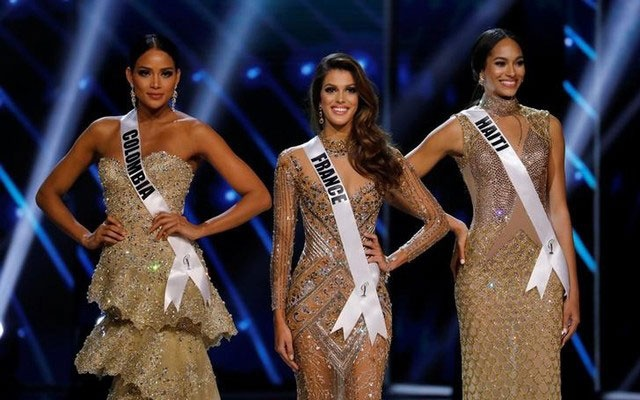 Miss France Iris Mittenaere (C) and other finalists Miss Haiti Jacque Pellisier (R) and Miss Colombia Andrea Tovar pose shortly before Mittenaere wins the 65th Miss Universe beauty pageant at the Mall of Asia Arena, in Pasay, Metro Manila, Philippines January 30, 2017. Reuters