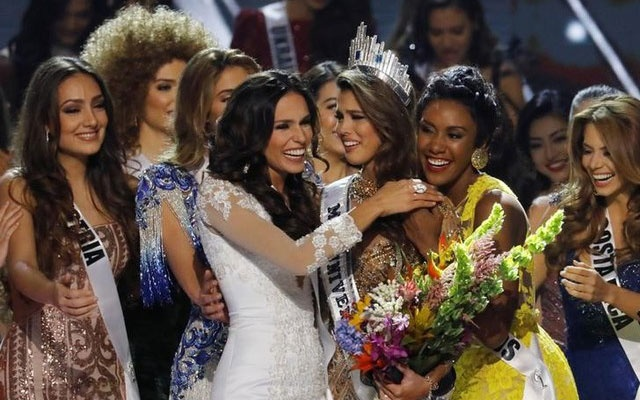 Contestants congratulate Miss France Iris Mittenaere after she won the 65th Miss Universe beauty pageant at the Mall of Asia Arena, in Pasay, Metro Manila, Philippines January 30, 2017. Reuters