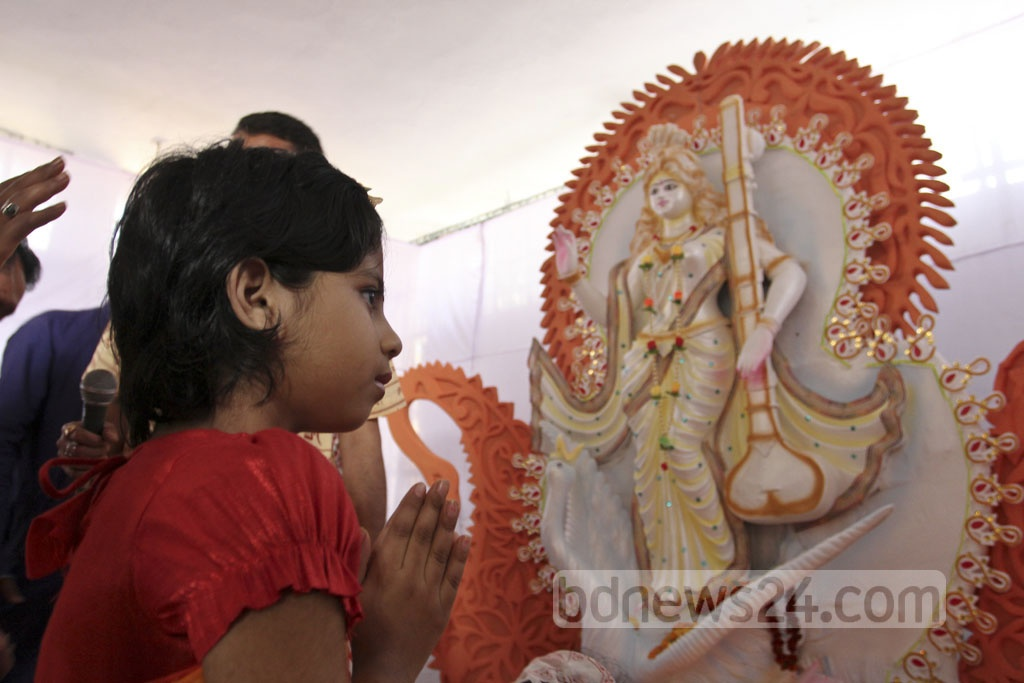 A student prays to the goddess Saraswati at Dhaka University's Jagannath Hall on Wednesday. Photo: asif mahmud ove