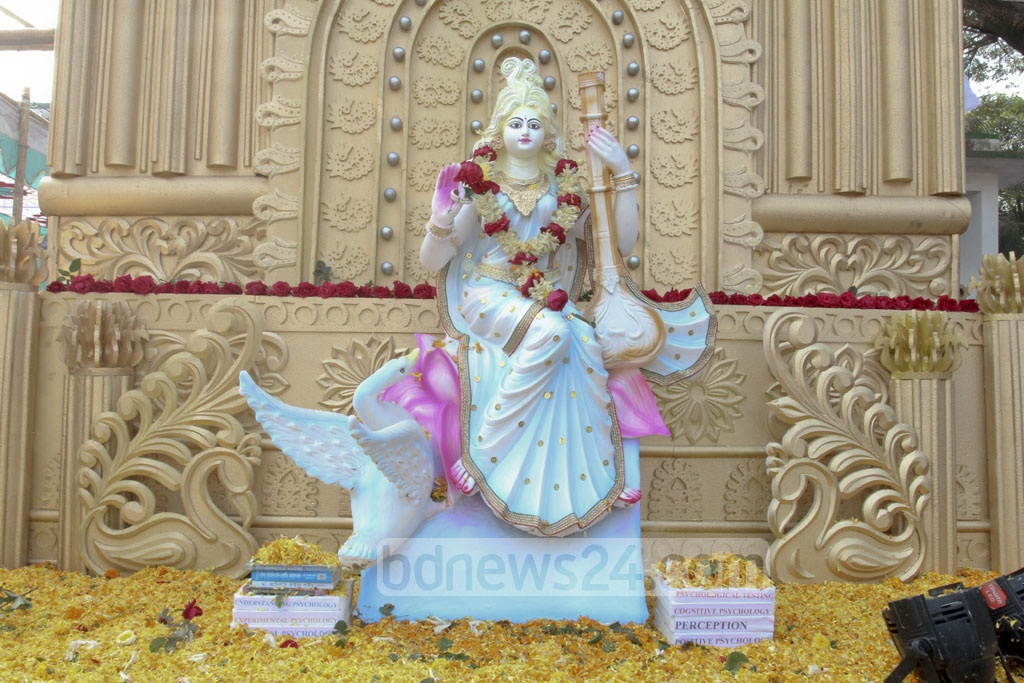 An idol of the goddess Saraswati on the Jagannath Hall grounds in celebration of Saraswati Puja on Wednesday. Photo: asif mahmud ove