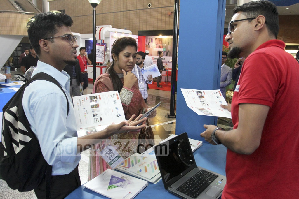 Visitors peruse a stall at the 'BASIS Softexpo 2017' Bangabandhu International Conference Centre in Dhaka on Wednesday. Photo: asif mahmud ove