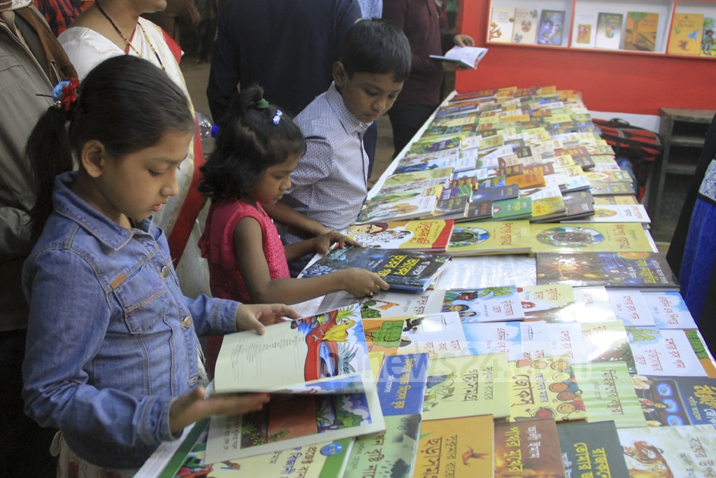 Children at the stalls on the first day of the book fair at Suhrawardy Udyan on Wednesday. Photo: abdul mannan