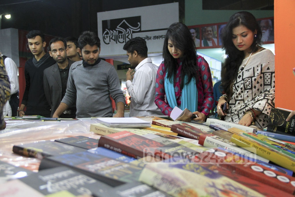 Visitors at the book fair premises at Suhrawardy Udyan after its inauguration. Photo: abdul mannan