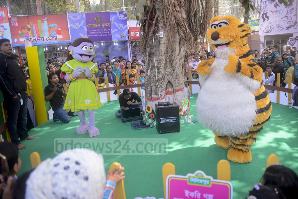 Children enter the world of books during 'Children's Hour' at the Amar Ekushey Book Fair on Friday. Characters of the television show 'Sisimpur' arrive to entertain their young audience.