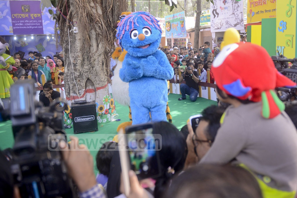 Characters from television show 'Sisimpur' entertain a mostly young audiences during Children's Hour at the Amar Ekushey Book Fair on Friday.