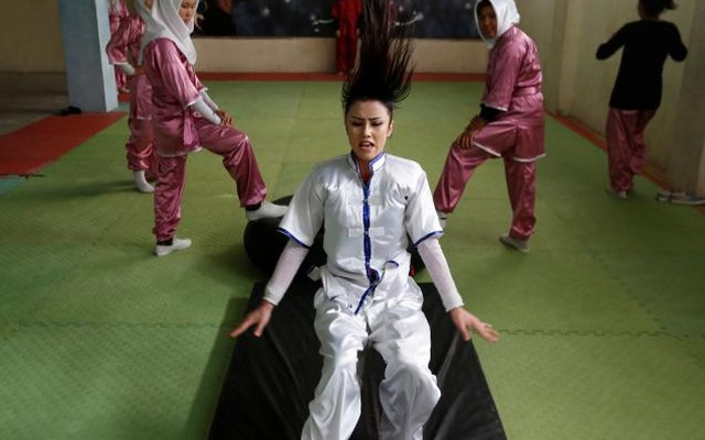 Sabera Bayanne, 20, a student of the Shaolin Wushu club, practices in Kabul, Afghanistan January 29, 2017. Reuters
