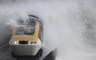 Trains braved the waves throwing up spectacular showers of spray along one of Britain's most scenic rail stretches in Dawlish on Thursday. Reuters