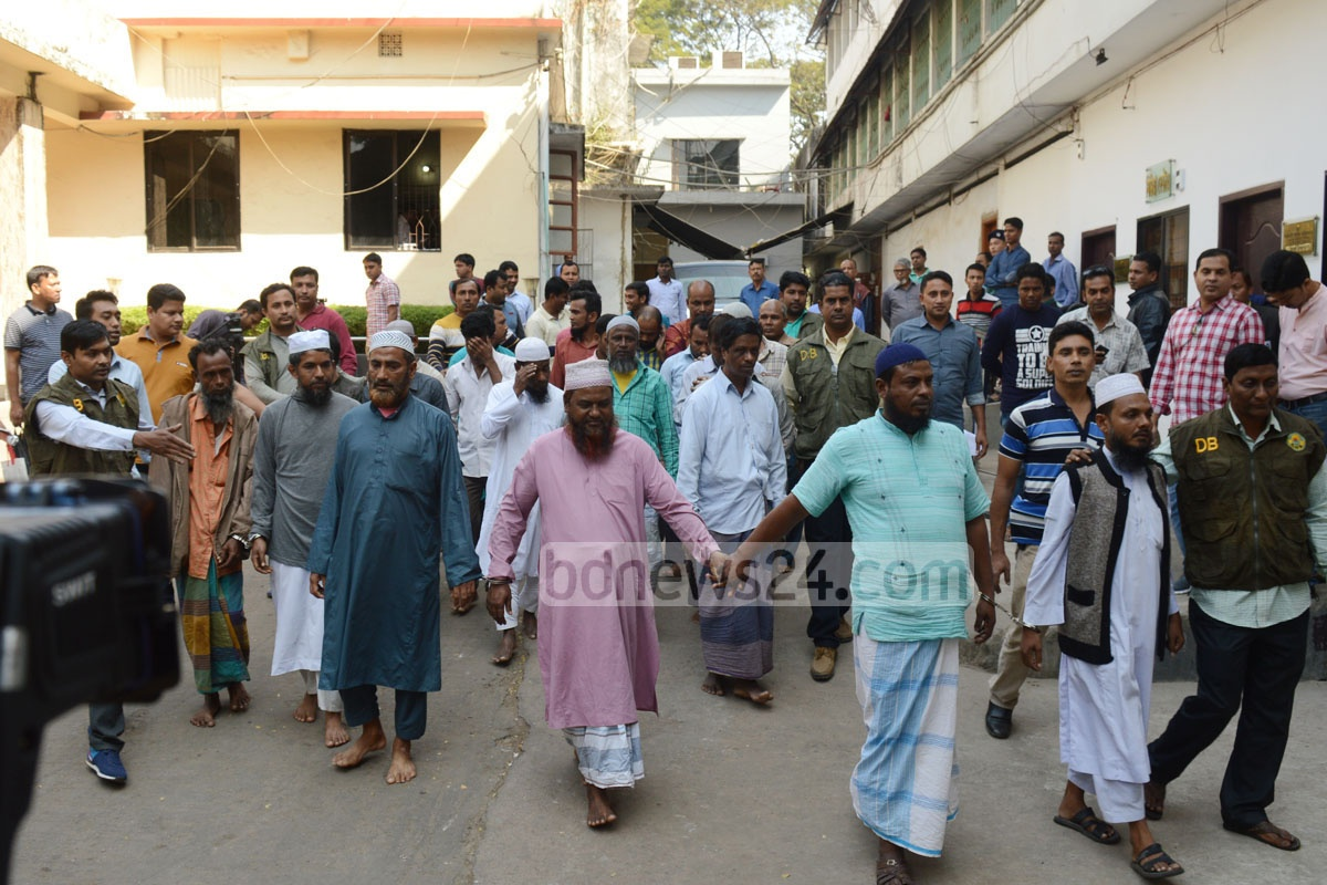 Police detain 24 members of an organisation named 'Islami Society' from a building in Chittagong's Pahartali area on Saturday. Photo: suman babu