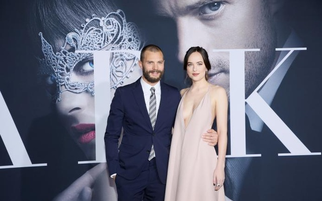 Cast members Jamie Dornan (left) and Dakota Johnson pose at the premiere of the film 'Fifty Shades Darker' in Los Angeles, California, Feb 2, 2017. Reuters