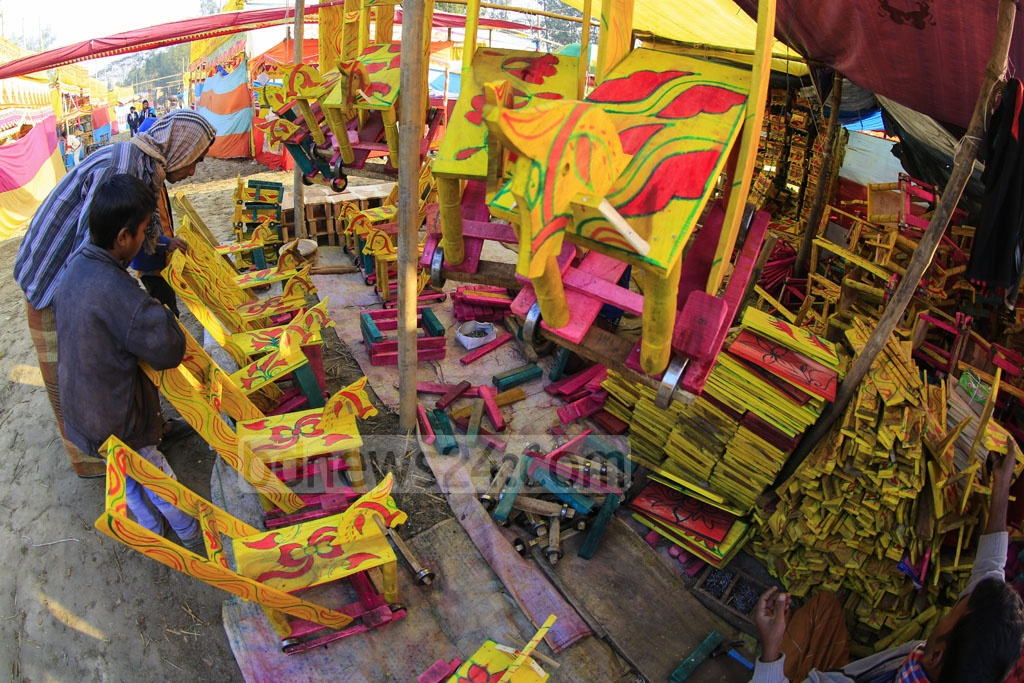 Locally-made toys are on display at a stall in 'Poradah Fair' in Bogra.