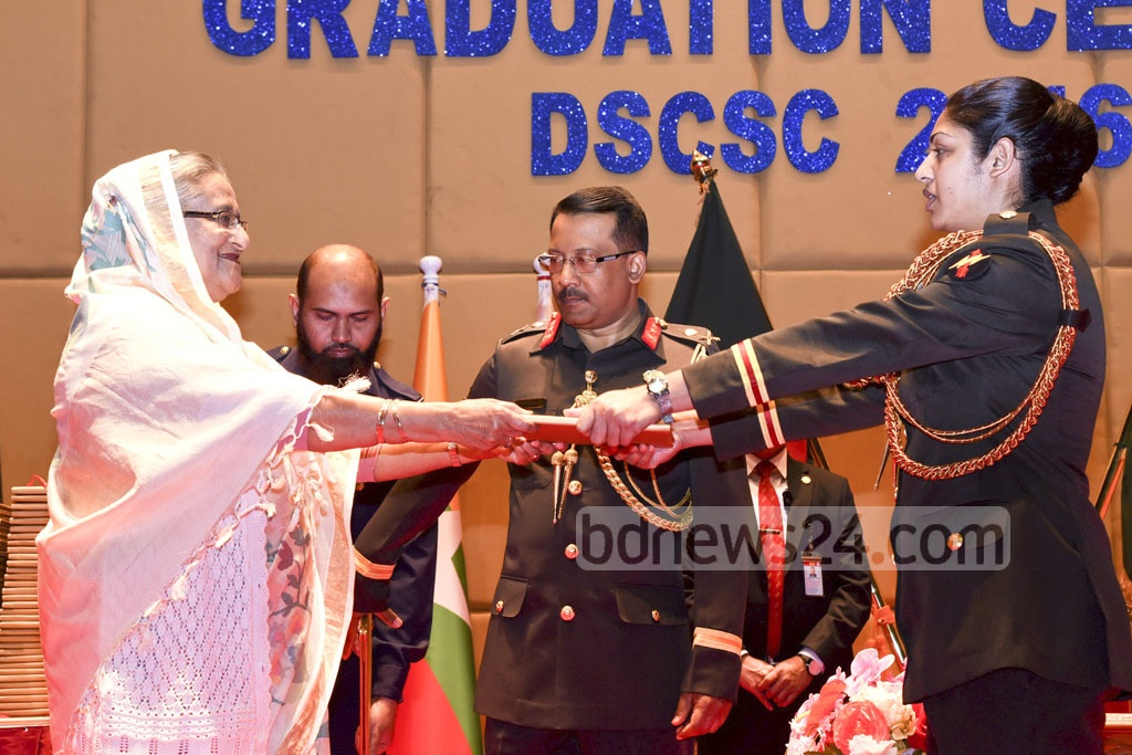 Prime Minister Sheikh Hasina handing certificates to graduates of Defence Services Command and Staff College 2016-17 batch at Dhaka's Mirpur Cantonment on Wednesday. Photo: Saiful Islam Kallol