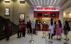 People stand outside a ticket counter at Atrium Mall & Cinemas in Karachi, Pakistan, Dec 19, 2016. Reuters
