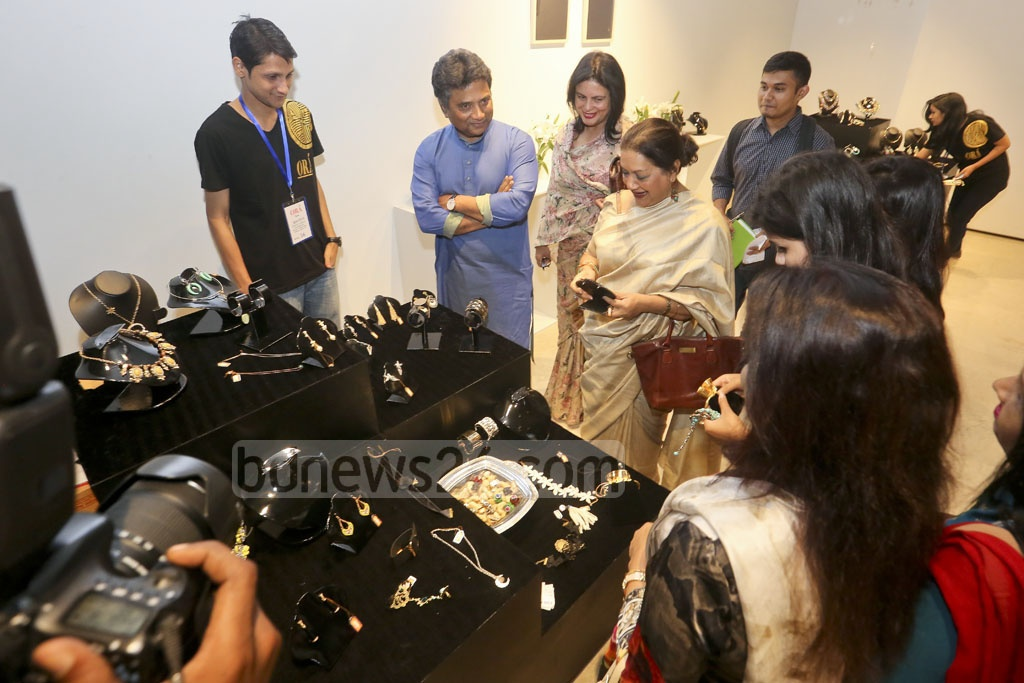 Bengali screen legend Sarah Begum Kabori, Dhaka North Mayor Annisul Huq and his wife look at jewellery by Ora at Gulshan's Edge Gallery on Friday.