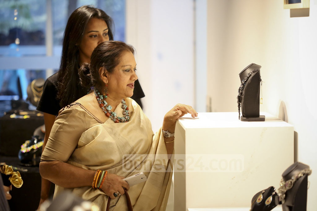 Bengali screen icon Sarah Begum Kabori looks at jewellery pieces at the opening of Ora's exhibition at Gulshan's Edge Gallery on Friday.