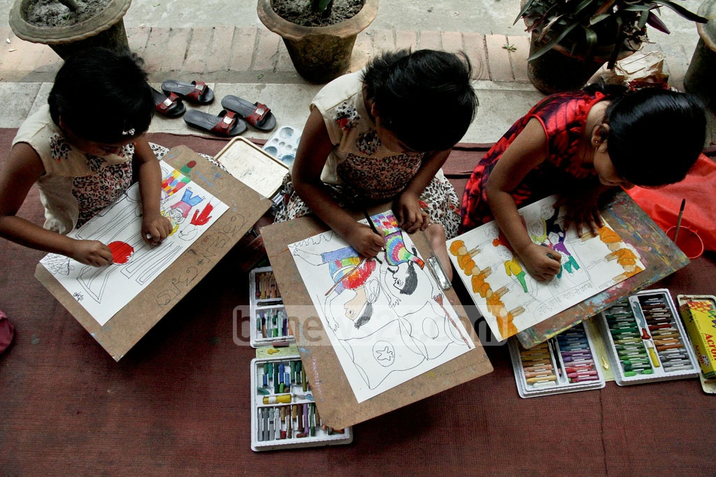 Children paint the Language Movement during a competition at the Dhaka University's Faculty of Fine Arts on Friday ahead of Martyrs' Day or International Mother Language Day. Photo: tanvir ahammed