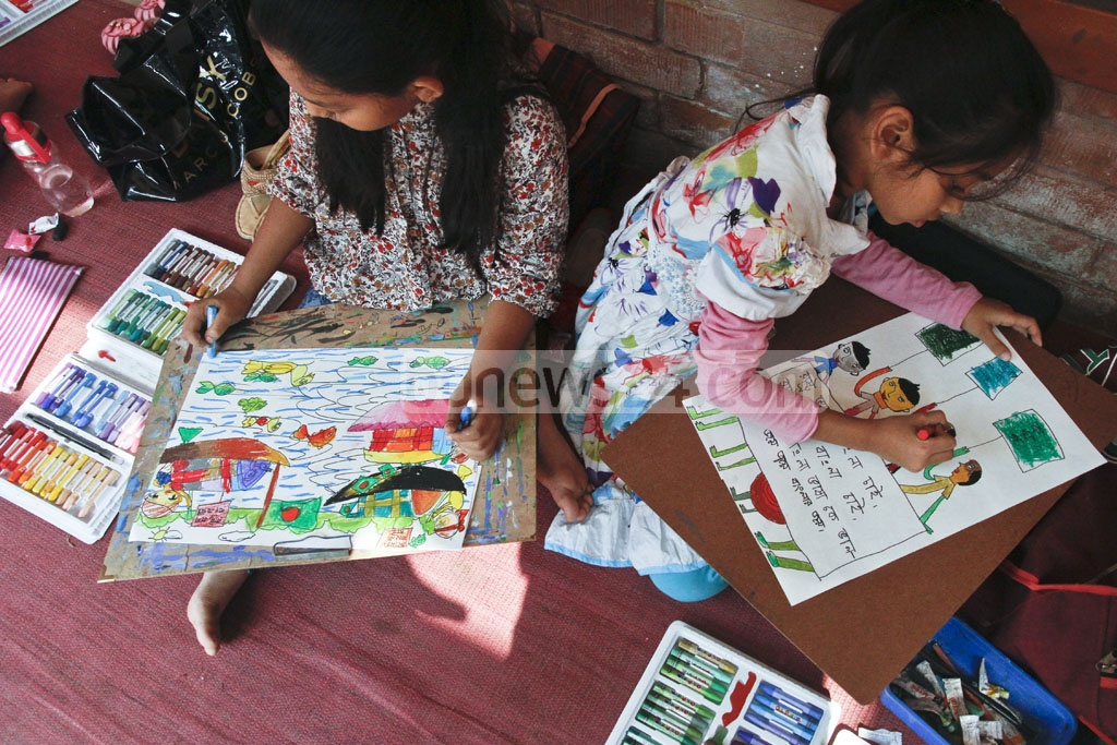 Many of the child participants of a painting competition on the Language Movement at the Dhaka University themed their works on the Shaheed Minar and the slogan 'Rashtra Bhasha Bangla Chai' or 'We demand Bangla be the state language'. Photo: tanvir ahammed
