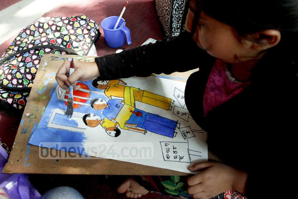 A child painting the bloodstained bodies of the Language Movement martyrs lying on the street. Photo: tanvir ahammed