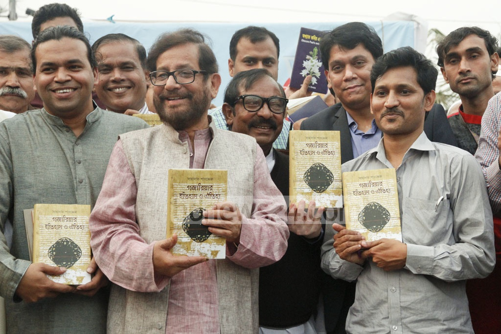 Cultural Affairs Minister Asaduzzaman Noor unveils the cover of the book titled 'Gazariar Itihas O Oitihyo' (The History and Tradition of Gazaria) by Shahadat Parvez at Amar Ekushey Book Fair on Saturday. photo: tanvir ahammed.