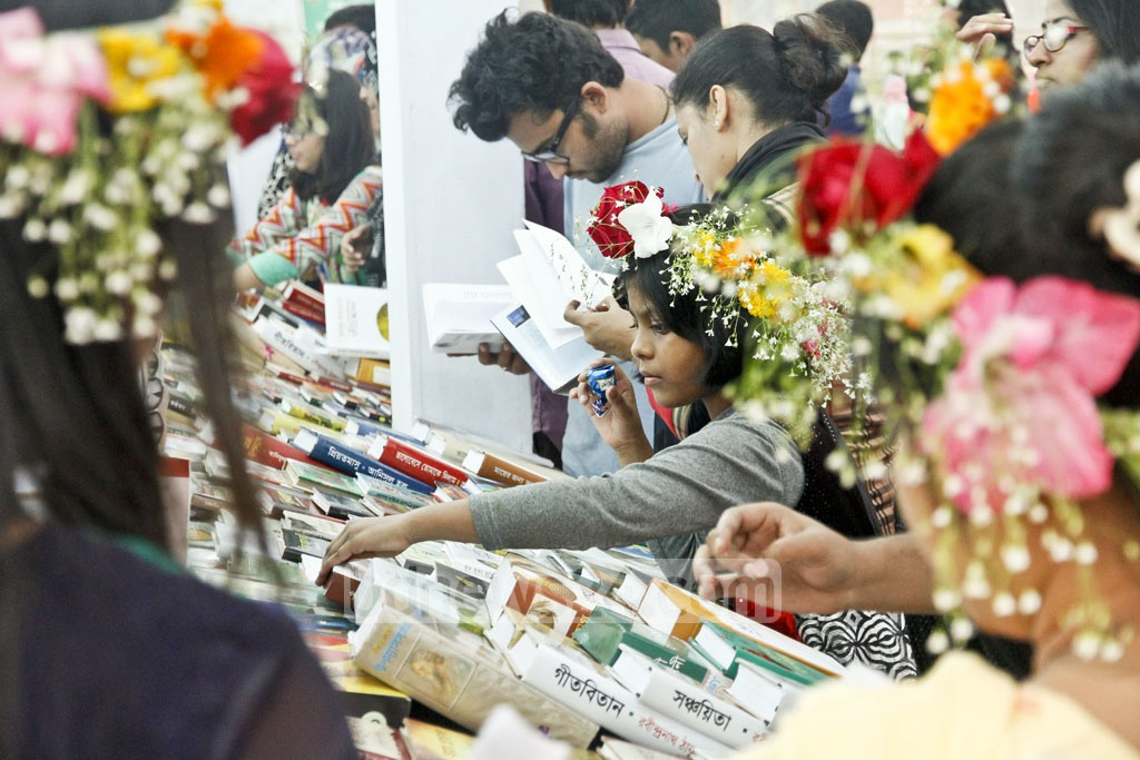 The Bengali month of Falgun, the first day of Spring, starts Monday but people have already started celebratibg the 'beauty of nature during Spring' as many visitors at the Ekushey Book Fair were seen wearing floral ornaments on Saturday. photo: tanvir ahammed.