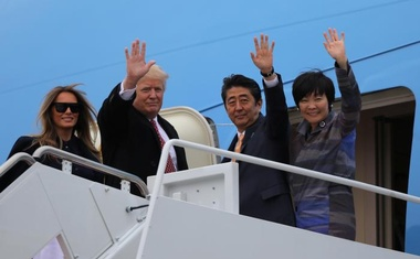 U.S. President Donald Trump and his wife Melania (L) wave with Japanese Prime Minister Shinzo Abe (2ndR) and his wife Akie Abe while boarding Air Force One as they depart for Palm Beach, Florida, at Joint Base Andrews, Maryland, U.S., February 10, 2017. Reuters