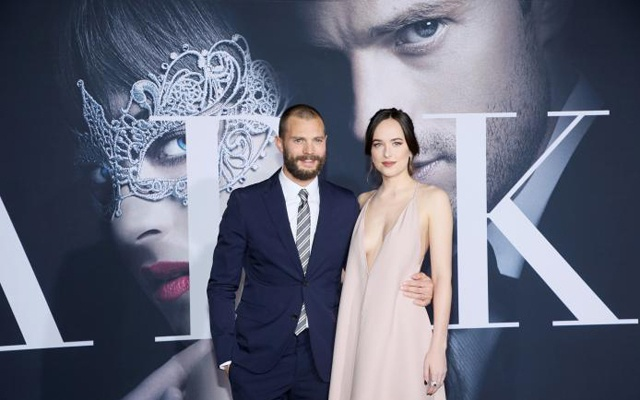 Jamie Dornan (L) and Dakota Johnson pose at the premiere of the film 'Fifty Shades Darker' in Los Angeles, California, US on February 2, 2017. Reuters