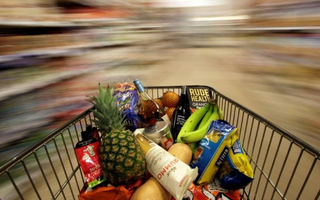 FILE PHOTO: A shopping trolley is pushed around a supermarket in London, Britain May 19, 2015. Reuters