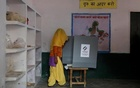 A woman looks at the Electronic Voting Machine (EVM) before casting her vote inside a booth at a polling station during the state assembly election in Hapur, in the central state of Uttar Pradesh, India, Feb 11, 2017. Reuters