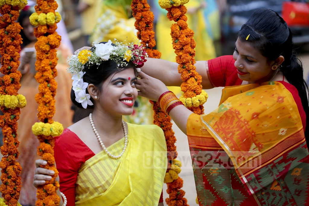 Women at Dhaka University add fresh flowers to bright outfits as they join festivities on the first day of spring. Photo: asaduzzaman pramanik