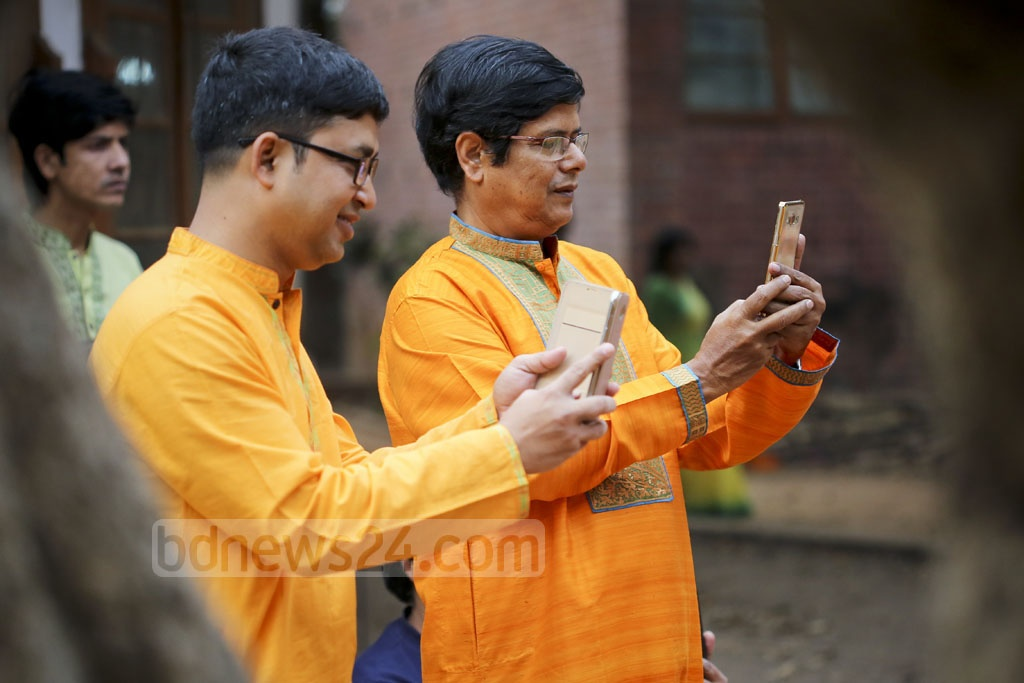 People taking part in spring celebrations at Dhaka University capture the moments with their phone cameras. Photo: asaduzzaman pramanik